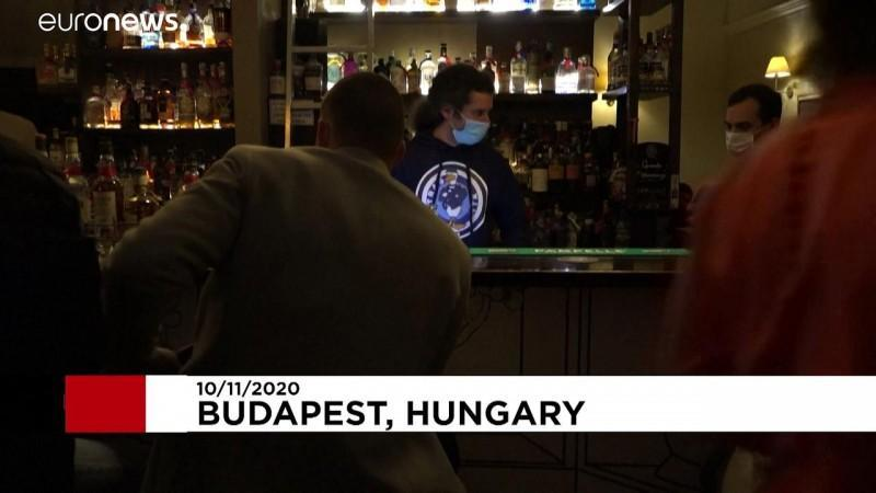 Last orders in Budapest before closure of bars and restaurants as virus cases soar