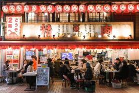 Desperate restaurants defy Japan's virus curbs to stay open late